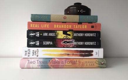 Stack of books: 84, Charing Cross road by Helene Hanff, Real Life by Brendan Taylor, Ark Angel and Scorpia by Anthony Horowitz, The Yield by Tara June Winch, and Two Trees Make a Forest by Jessica J. Lee